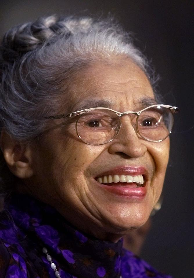 FILE -- In a June 15, 1999 file photo Rosa Parks smiles during a Capitol Hill ceremony where Parks was honored with the Congressional Gold Medal in Washington. Parks will become the first black woman to be honored with a full-length statue in the Capitol's Statuary Hall on Wednesday Feb. 27, 2013. (AP Photo/Khue Bui)