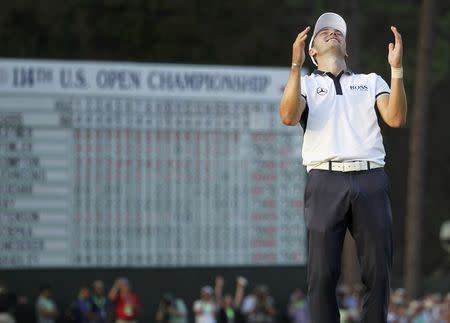 Martin Kaymer of Germany celebrates on the 18th green after sinking his final putt to capture the U.S. Open Championship golf tournament in Pinehurst