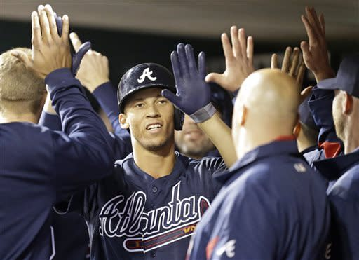 Simmons homers twice, Braves beat Reds 7-4