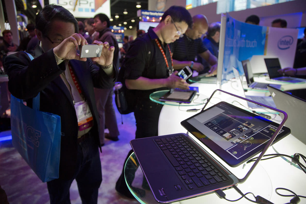 An electronics industry affiliate photographs Dell's XPS Ultrabook convertible at the Consumer Electronics Show.