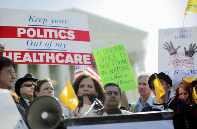 Rep. Michele Bachmann, R-Minn., addresses Tea Party supporters and opponents of health care reform in front of the Supreme Court.