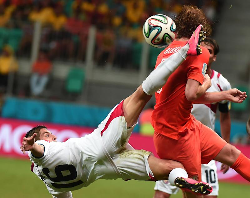 Costa Rica's defender Cristian Gamboa (L) vies with Netherlands' defender Daley Blind during the 2014 FIFA World Cup on July 5, 2014