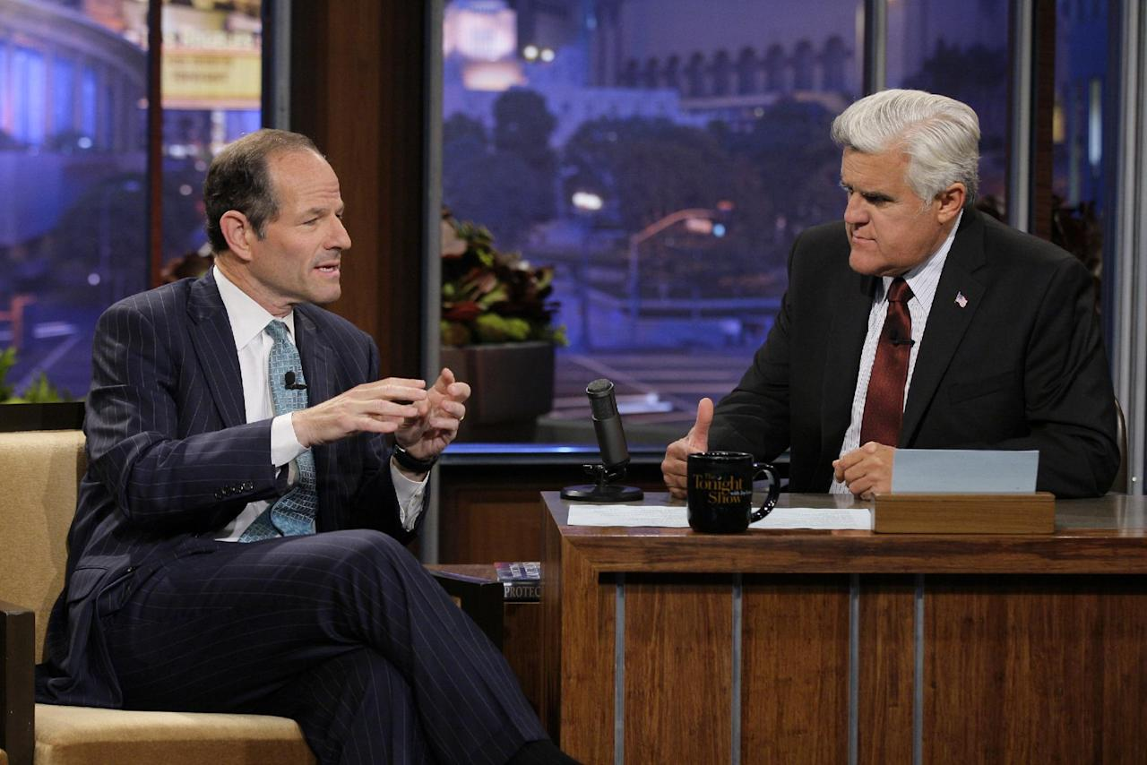 "This publicity image released by NBC shows former New York Gov. Eliot Spitzer, left, talking with host Jay Leno during a taping of ""The Tonight Show with Jay Leno,"" Friday, July 12, 2013, in Burbank, Calif. Spitzer, who resigned as governor in 2008 amid a prostitution scandal, is now running for New York City comptroller. (AP Photo/NBC, Paul Drinkwater"