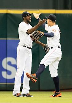 Dexter Fowler (L) and George Springer celebrate Thursday's win over Baltimore. (Getty)