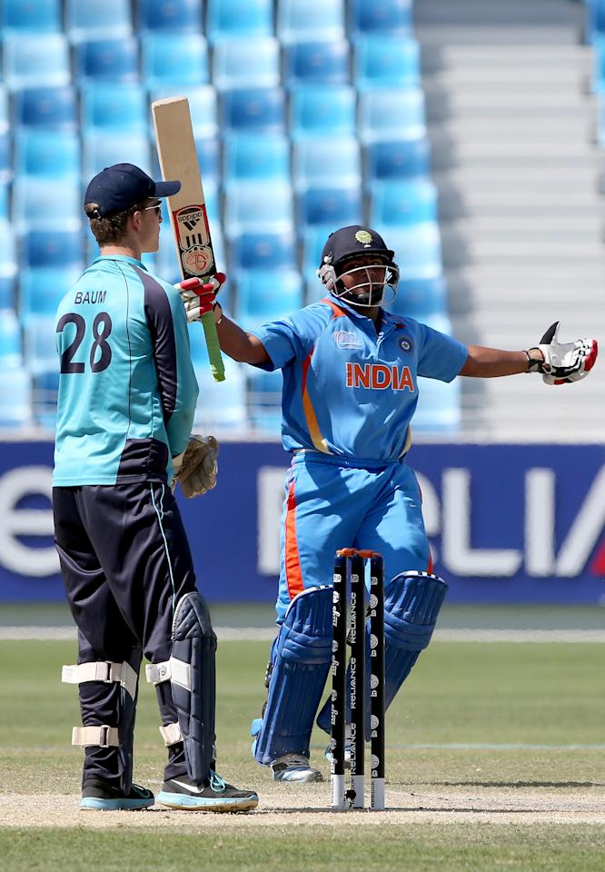 DUBAI, UNITED ARAB EMIRATES - FEBRUARY 17: Sarfaraz Khan of India celebrates after hitting the winning runs during the ICC U19 Cricket World Cup 2014 match between India and Scotland at the Dubai Sports City Cricket Stadium on February 17, 2014 in Dubai, United Arab Emirates.  (Photo by Francois Nel - IDI/IDI via Getty Images)