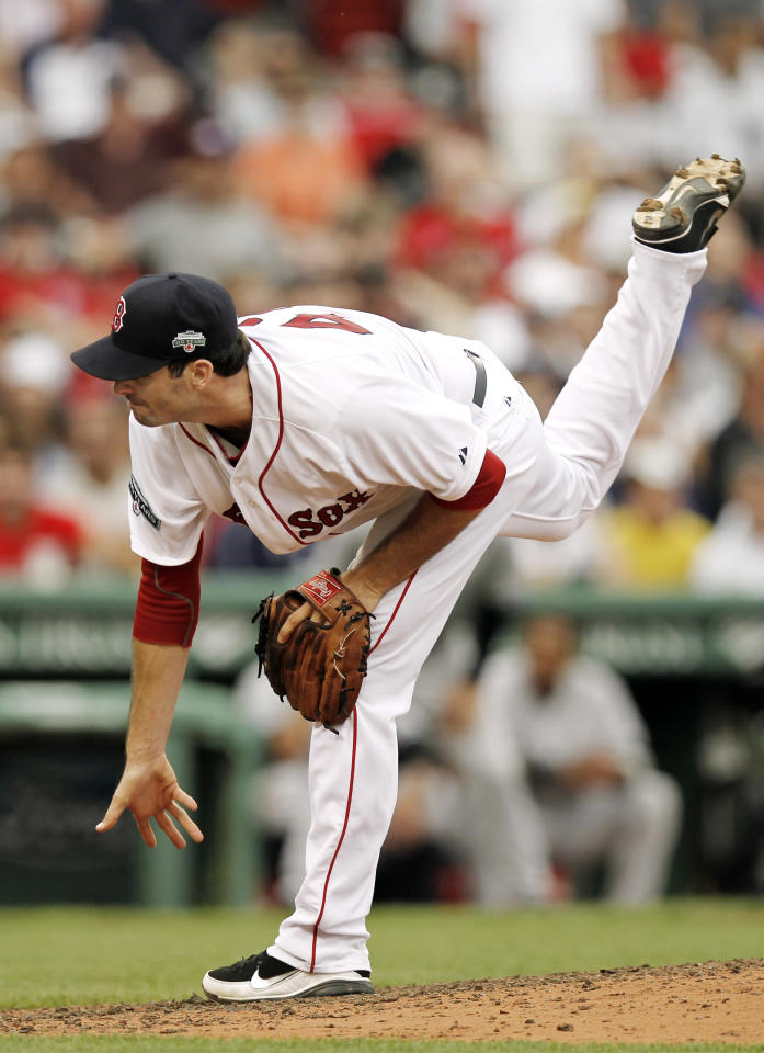 BOSTON, MA - JULY 7: Justin Germano #47 of the Boston Red Sox pitches during the ninth inning of game one of a doubleheader against the New York Yankees at Fenway Park on July 7, 2012 in Boston, Massachusetts. (Photo by Winslow Townson/Getty Images)