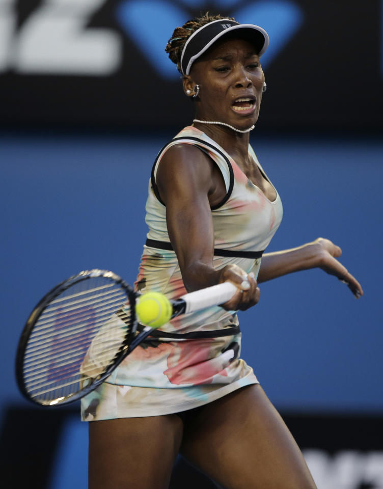 Venus Williams of the US hits a forehand to France's Alize Cornet during their second round match at the Australian Open tennis championship in Melbourne, Australia, Wednesday, Jan. 16, 2013. (AP Photo/Rob Griffith)