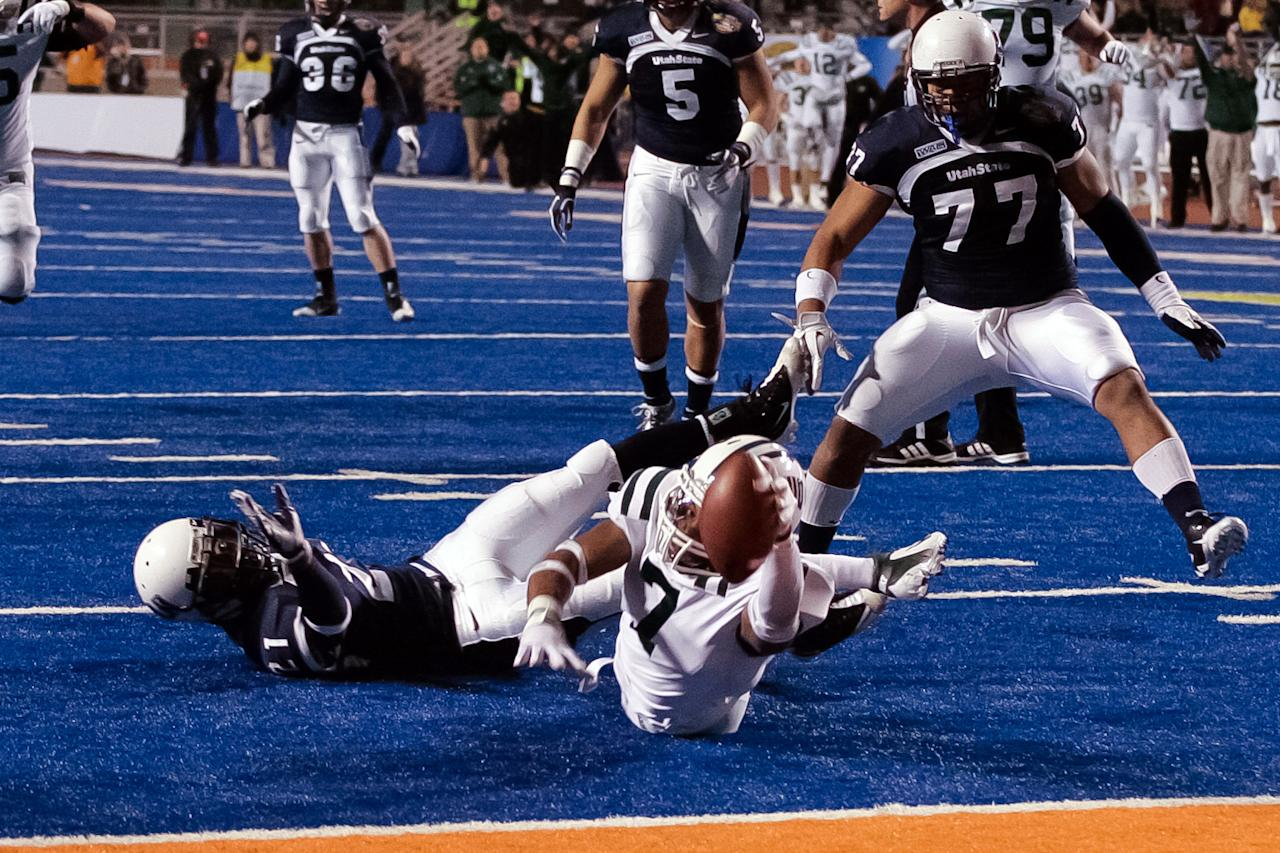 LaVon Brazill #7 of the Ohio Bobcats gets the ball to the six inch line against the Utah State Aggies at Bronco Stadium on December 17, 2011 in Boise, Idaho.  (Photo by Otto Kitsinger III/Getty Images)
