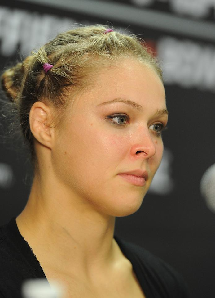 August 18, 2012; San Diego, CA, USA;    Ronda Rousey during the post fight press conference after defeating Sarah Kaufman (not pictured) in their Strikeforce MMA women's bantamweight title bout at the Valley View Casino Center. Rousey won in 54 seconds of the first round. Mandatory Credit: Jayne Kamin-Oncea-USA TODAY Sports