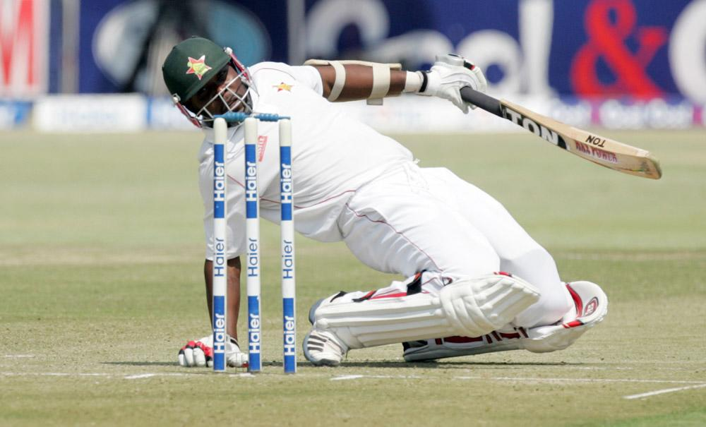Zimbabwe batsman Hamilton Masakadza ducks a short delivery during the first day of the second test match between Pakistan and hosts Zimbabwe at the Harare Sports Club on September 10, 2013. AFP PHOTO / JEKESAI NJIKIZANA        (Photo credit should read JEKESAI NJIKIZANA/AFP/Getty Images)