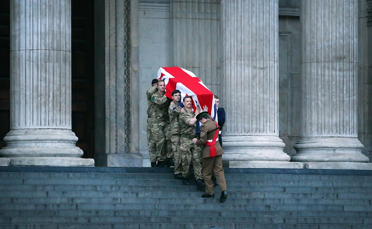 LONDON, ENGLAND - APRIL 15:  Members of a military honour guard wait to take part in a rehearsal for the ceremonial funeral of former Prime Minister Margaret Thatcher on the steps of St Paul's Cathedral on April 15, 2013 in London, England. Lady Thatcher's coffin will be carried on a gun carriage though the City of London to St Paul's cathedral where a funeral service will be held on April 17.  (Photo by Peter Macdiarmid/Getty Images)