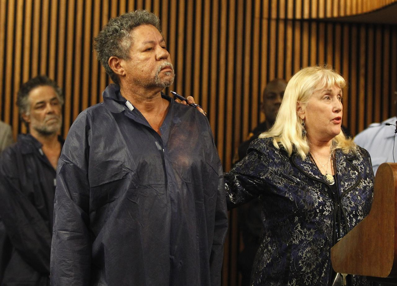 CLEVELAND, OH - MAY 09:  Pedro Castro stands with his public defender, Kathleen DeMetz, during his arraignment for an open container charge from 2011 on May 9, 2013 in Cleveland, Ohio.  His brother, Ariel Castro, was arraigned on rape and kidnapping charges for abducting Michelle Knight, Amanda Berry and Gina DeJesus and holding them for about 10 years. No charges were filed against Pedro and he was released by the judge. (Photo by Matt Sullivan/Getty Images)