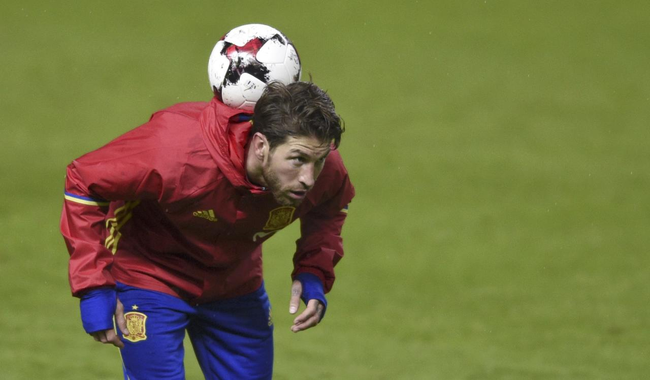 Football Soccer - Spain training session - World Cup 2018 Qualifiers - El Molinon stadium, Gijon, Spain, 23/03/17  Spain's Sergio Ramos controls the ball during training session. REUTERS/Eloy Alonso