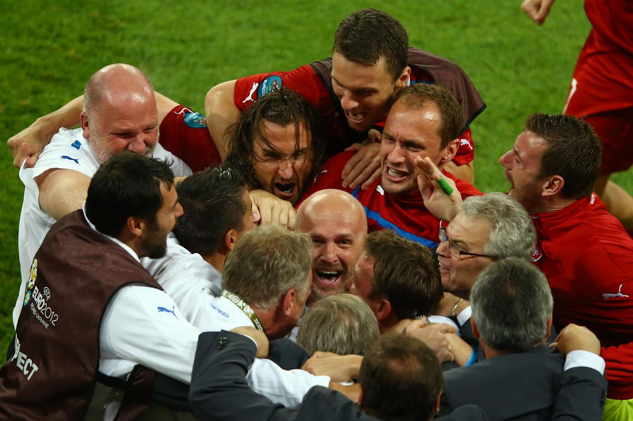 WROCLAW, POLAND - JUNE 16:  Head Coach Michal Bilek of Czech Republic is mobbed by players and staff at the final whistle during the UEFA EURO 2012 group A match between Czech Republic and Poland at The Municipal Stadium on June 16, 2012 in Wroclaw, Poland.  (Photo by Clive Mason/Getty Images)