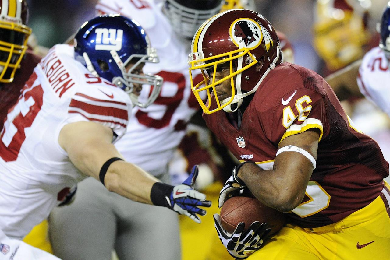Washington Redskins running back Alfred Morris (46) carries the ball past New York Giants middle linebacker Chase Blackburn (93) during the first half of an NFL football game in Landover, Md., Monday, Dec. 3, 2012. (AP Photo/Nick Wass)