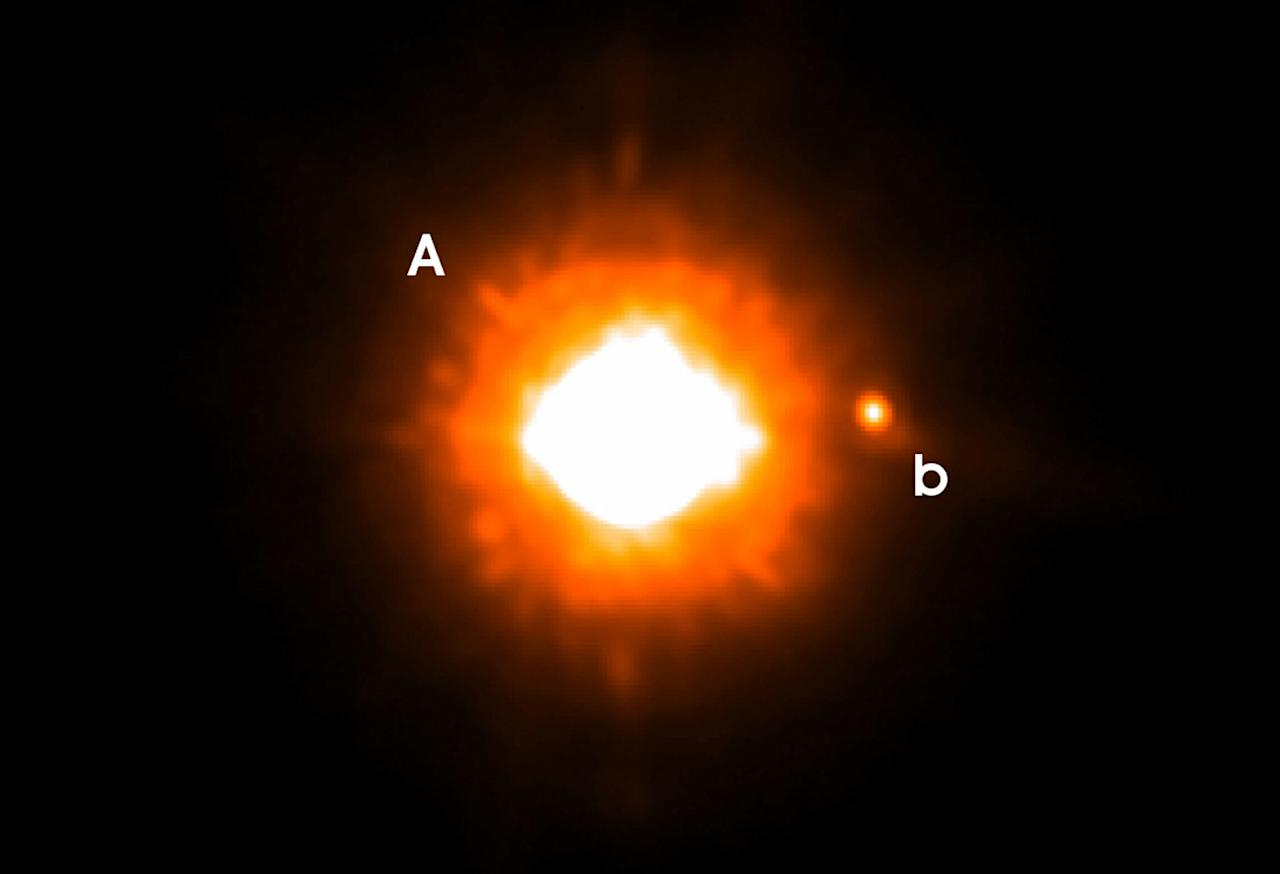 A handout image received April 5, 2005 from the University of Jena and the European Space Observatory ( ESO) shows the first photograph of a planet (B) beyond our solar system and the star, GQ Lupi (A) around which it orbits. The planet is thought to be one to two times as massive as Jupiter, according to the scientists who imaged it. It orbits a star similar to a young version of our Sun. Reuters