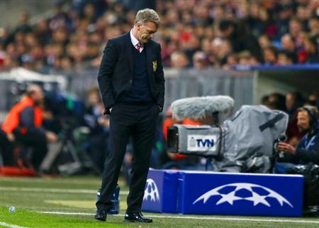 Manchester United's manager Moyes reacts after their Champions League quarter-final second leg soccer match against Bayern Munich in Munich