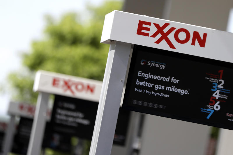 Exxon Mobil profit more than doubles on cost cuts, oil price rise
