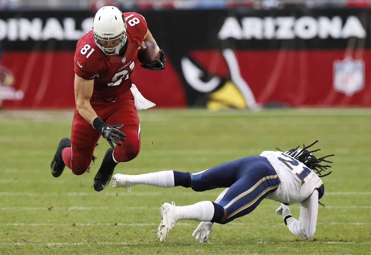 Arizona Cardinals tight end Jim Dray (81) leaps over the tackle of St. Louis Rams cornerback Janoris Jenkins (21) during the second half of an NFL football game, Sunday, Dec. 8, 2013, in Glendale, Ariz. (AP Photo/Ross D. Franklin)