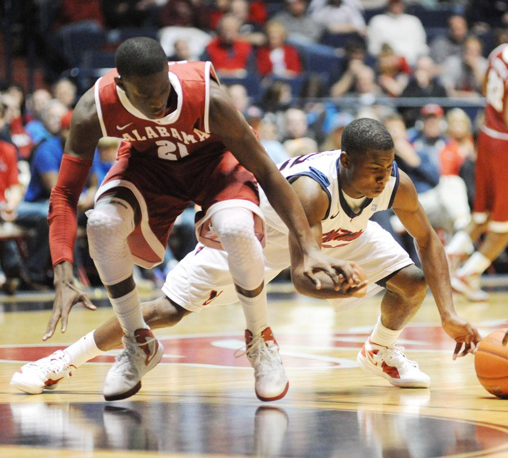 Mississippi's Jarvis Summers (32) and Alabama's Rodney Cooper (21) go for the ball during an NCAA college basketball game in Oxford, Miss. on Saturday, March 3, 2012.