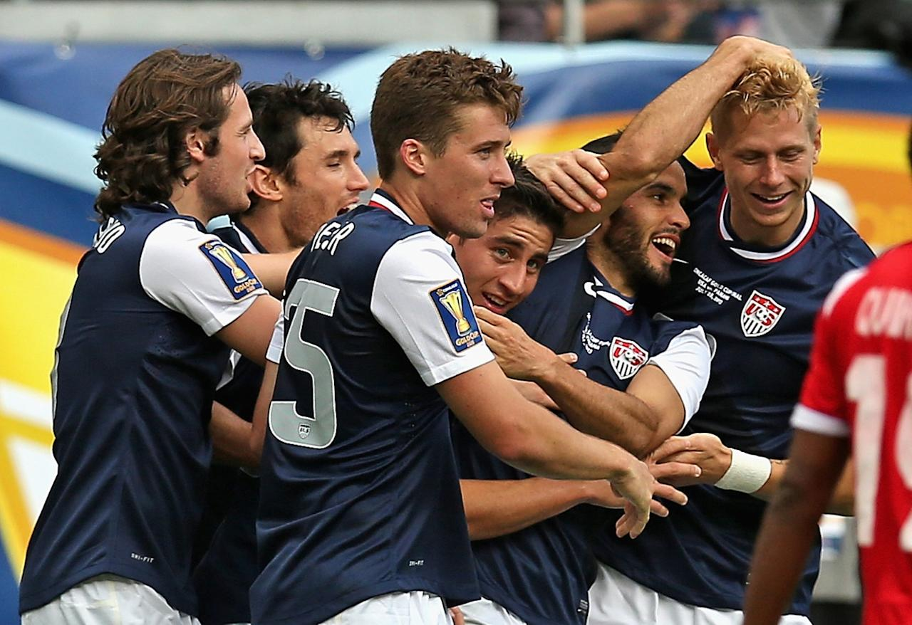CHICAGO, IL - JULY 28: Members of the United States including Michael Parkhurst #15 and Landon Donovan #10 celebrate with Brek Shea #23 (R) after Shea scored the game-winning goal against Panama during the CONCACAF Gold Cup final match at Soldier Field on July 28, 2013 in Chicago, Illinois. The United States defeated Panama 1-0. (Photo by Jonathan Daniel/Getty Images)
