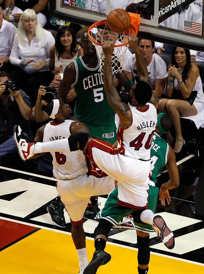 MIAMI, FL - JUNE 09:  Udonis Haslem #40 of the Miami Heat is called for interference as he touches the ball as it is on the rim after teammate Dwyane Wade #3 misses a layup in the first quarter against the Boston Celtics in Game Seven of the Eastern Conference Finals in the 2012 NBA Playoffs on June 9, 2012 at American Airlines Arena in Miami, Florida. NOTE TO USER: User expressly acknowledges and agrees that, by downloading and or using this photograph, User is consenting to the terms and conditions of the Getty Images License Agreement.  (Photo by J. Meric/Getty Images)