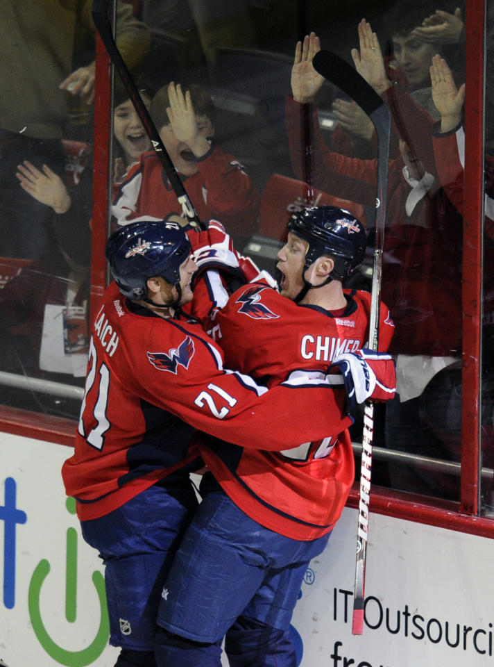 Washington Capitals left wing Jason Chimera, right, celebrates his goal with teammate Brooks Laich, left, during the second period of an NHL hockey game against the Pittsburgh Penguins, Thursday, Dec. 1, 2011, in Washington. (AP Photo/Nick Wass)