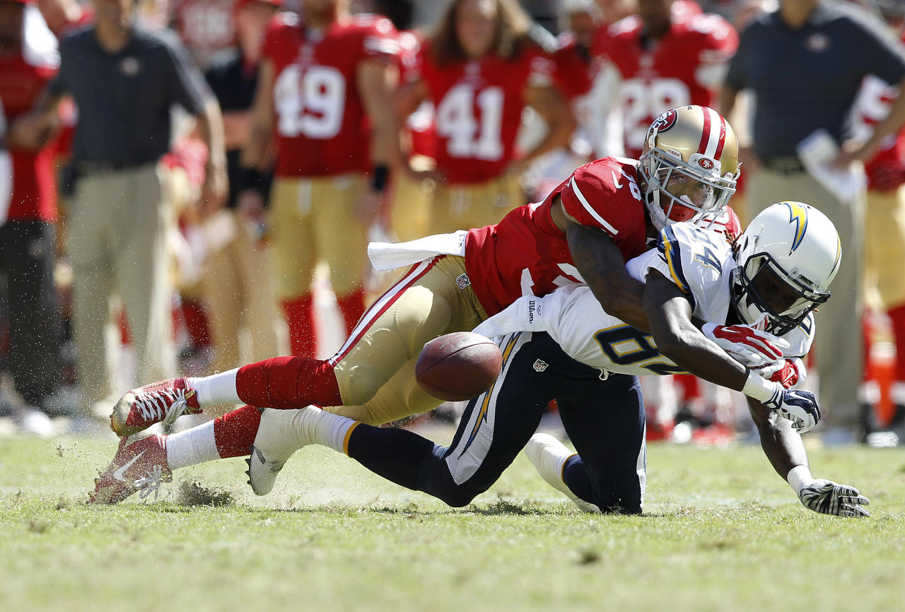 San Francisco 49ers defensive back Dontae Johnson (36), top, hits San Diego Chargers wide receiver Tevin Reese (84) during the second half of an NFL preseason football game in Santa Clara, Calif., Sunday, Aug. 24, 2014. (AP Photo/Mathew Sumner)