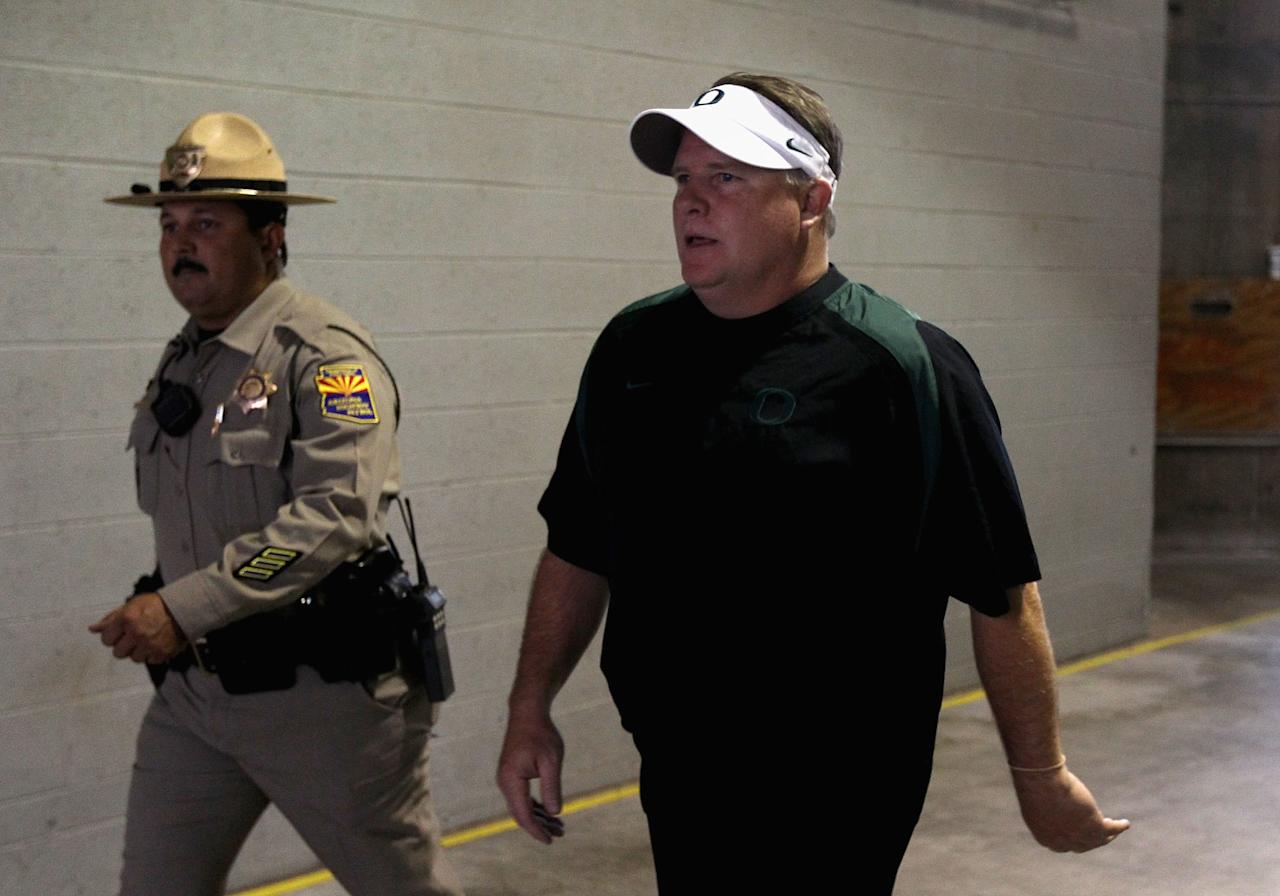 TEMPE, AZ - OCTOBER 18:  Head coach Chip Kelly of the Oregon Ducks walks out onto the field before the college football game against the Arizona State Sun Devils at Sun Devil Stadium on October 18, 2012 in Tempe, Arizona.  (Photo by Christian Petersen/Getty Images)