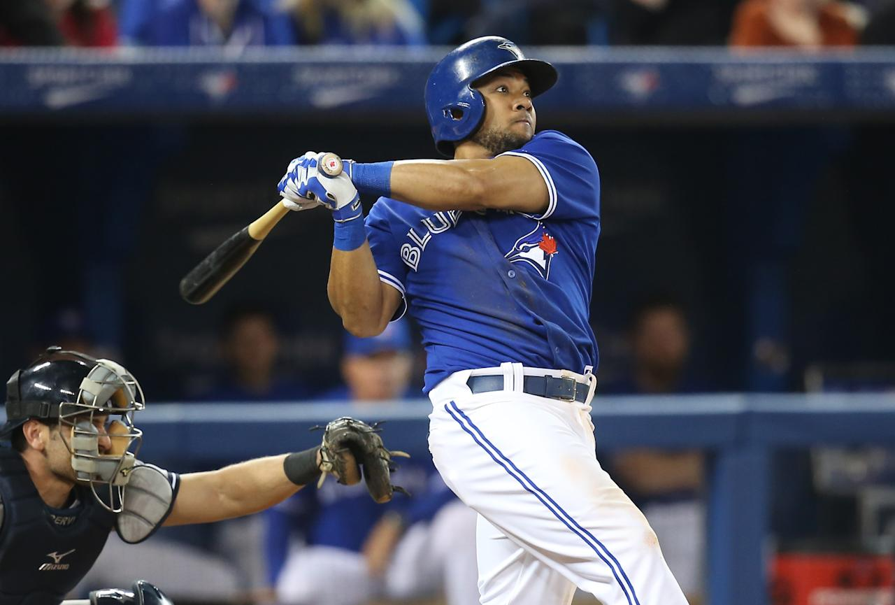 TORONTO, CANADA - APRIL 5: Melky Cabrera #53 of the Toronto Blue Jays hits a solo home run in the eighth inning during MLB game action against the New York Yankees on April 5, 2014 at Rogers Centre in Toronto, Ontario, Canada. (Photo by Tom Szczerbowski/Getty Images)
