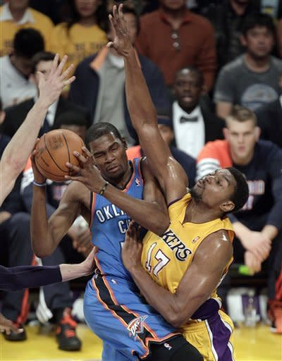 Oklahoma City Thunder's Kevin Durant, left, works against Los Angeles Lakers' Andrew Bynum during the first half in Game 3 of an NBA basketball playoffs Western Conference semifinal in Los Angeles, Friday, May 18, 2012. (AP Photo/Jae C. Hong)