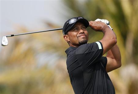 Woods of the U.S. tees off on the fourth hole during the second round of the 2014 Omega Dubai Desert Classic in Dubai