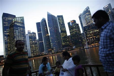Tourists take a boat cruise along the Singapore River in the central business district in Singapore