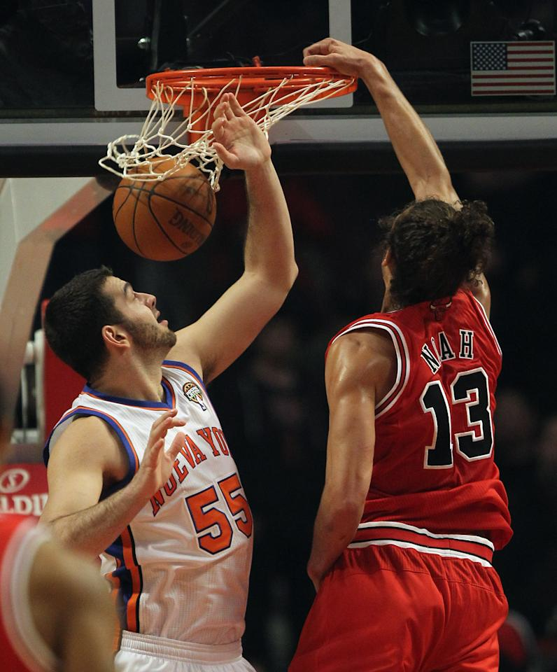 CHICAGO, IL - MARCH 12: Joakim Noah #13 of the Chicago Bulls dunks the ball against Josh Harrelison #55 of the New York Knicks at the United Center on March 12, 2012 in Chicago, Illinois. NOTE TO USER: User expressly acknowledges and agrees that, by downloading and or using this photograph, User is consenting to the terms and conditions of the Getty Images License Agreement. (Photo by Jonathan Daniel/Getty Images)