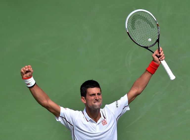 Novak Djokovic celebrates a point against Germany's Philipp Kohlschreiber during their 2014 US Open fourth round match in New York, on September 1, 2014