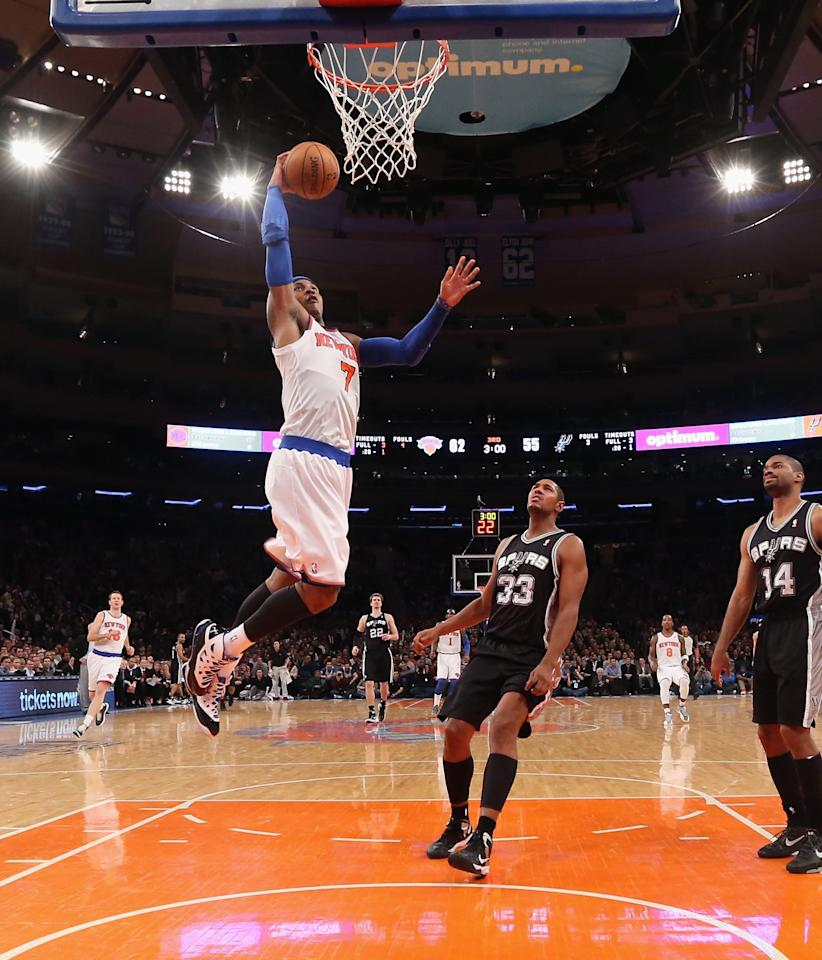 NEW YORK, NY - JANUARY 03: Carmelo Anthony #7 of the New York Knicks scores two against the San Antonio Spurs at Madison Square Garden on January 3, 2013 in New York City. NOTE TO USER: User expressly acknowledges and agrees that, by downloading and/or using this photograph, user is consenting to the terms and conditions of the Getty Images License Agreement. The Knicks defeated the Spurs 100-83. (Photo by Bruce Bennett/Getty Images)
