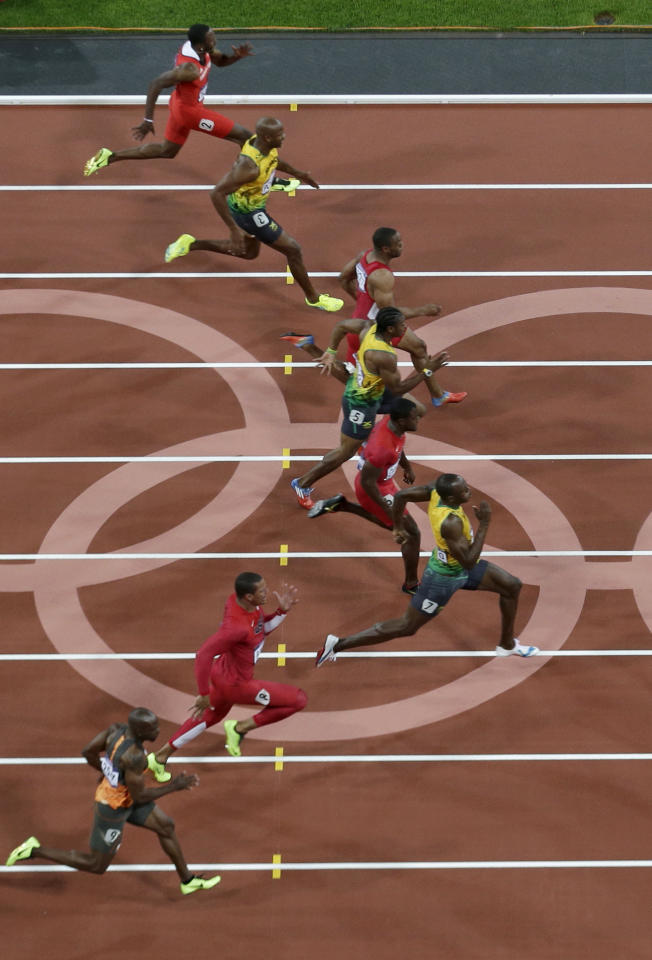 Jamaica's Usain Bolt, third from bottom, leads on his way to win the men's 100 meter final race during the athletics competition in the Olympic Stadium at the 2012 Summer Olympics, London, Sunday, Aug. 5, 2012. (AP Photo/Mark Duncan)
