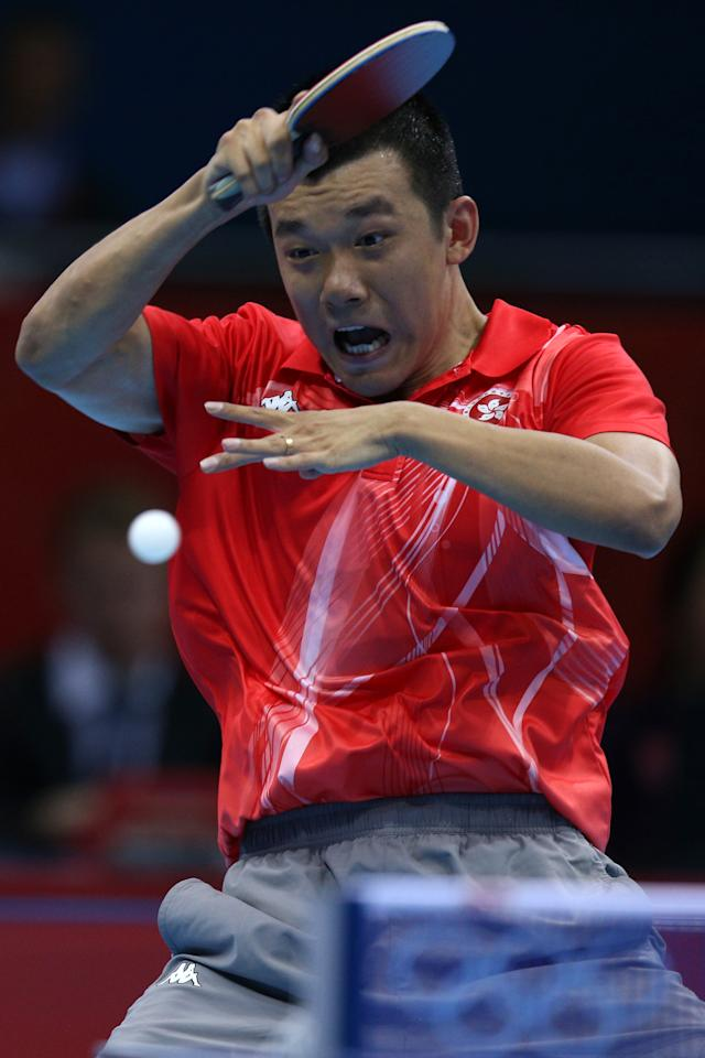 LONDON, ENGLAND - JULY 29:  Peng Tang of Hong Kong plays a forehand in his Men's Singles Table Tennis second round match against Noshad Alamiyan of Iran on Day 2 of the London 2012 Olympic Games at ExCeL on July 29, 2012 in London, England.  (Photo by Feng Li/Getty Images)