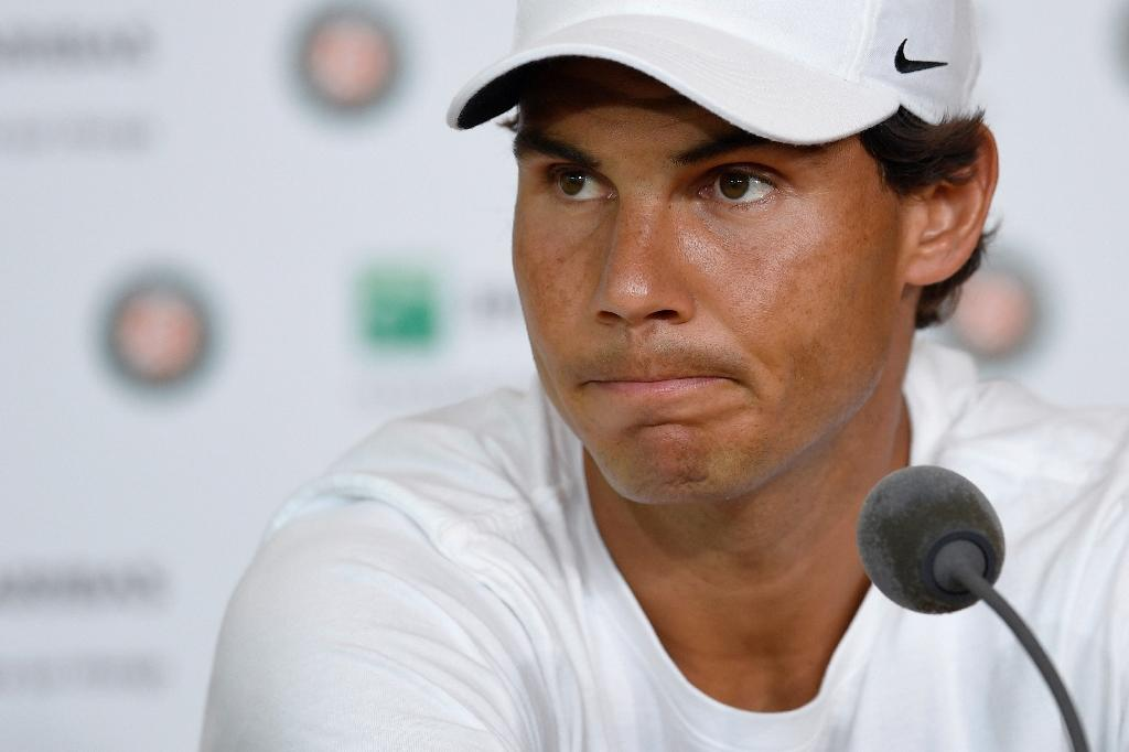 "Spain's Rafael Nadal, pictured on May 27, 2016, said that he just started practising a week ago after his wrist injury and that he is ""not ready to play such an important event"" (AFP Photo/Miguel Medina)"