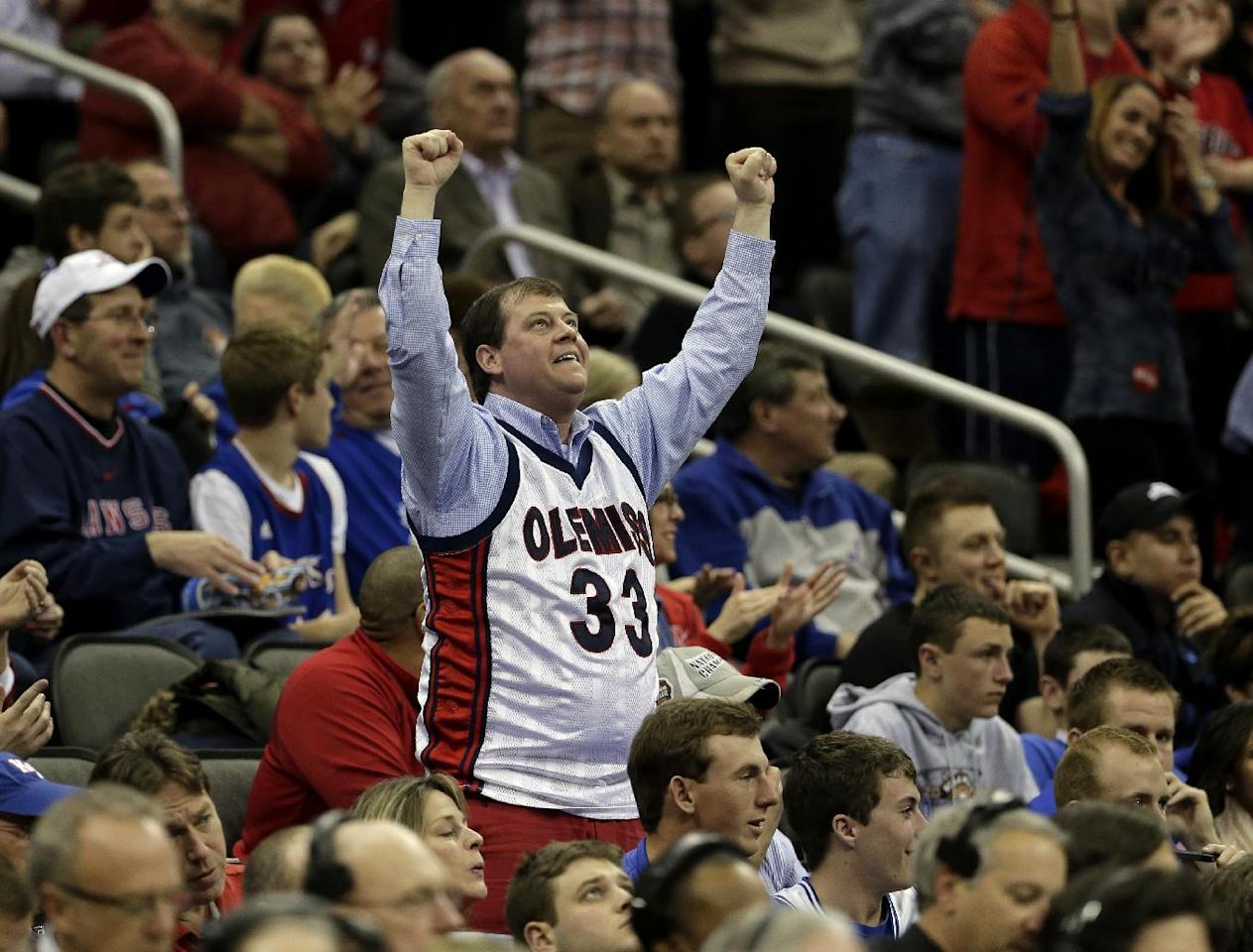 A Mississippi fan cheers during the first half of a third-round game against La Salle in the NCAA college basketball tournament Sunday, March 24, 2013, in Kansas City, Mo. (AP Photo/Charlie Riedel)