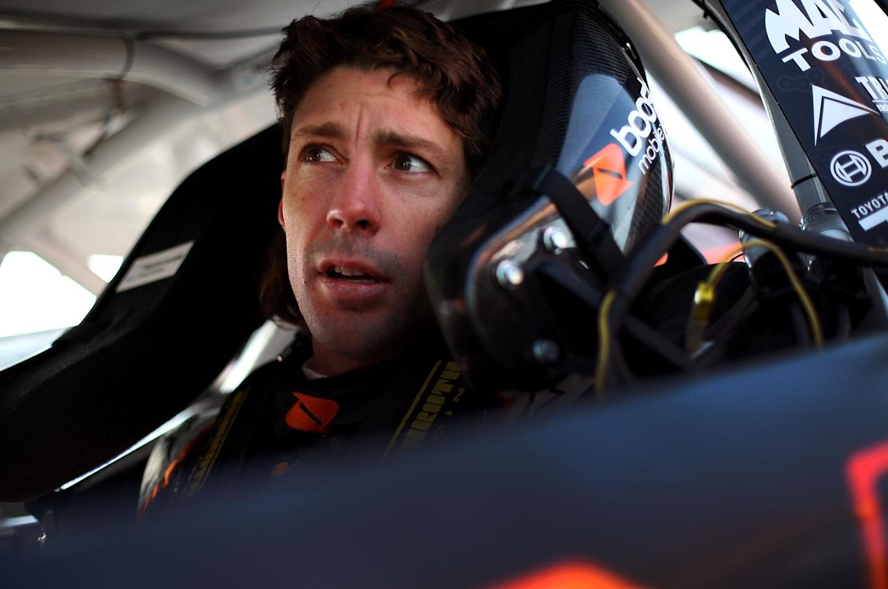 RICHMOND, VA - APRIL 27:  Travis Pastrana, driver of the #99 Boost Mobile Toyota, sits in his car in the garage during practice for the NASCAR Nationwide Series Virginia 529 College Savings 250 at Richmond International Raceway on April 27, 2012 in Richmond, Virginia.  (Photo by Tom Pennington/Getty Images for NASCAR)