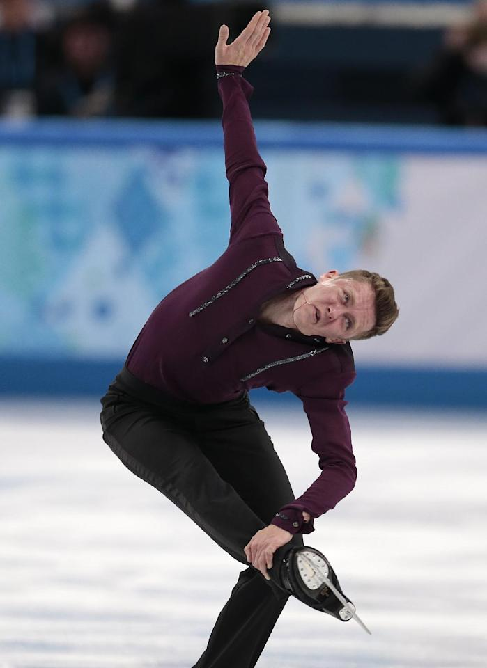 Jeremy Abbott of the United States competes in the men's team short program figure skating competition at the Iceberg Skating Palace during the 2014 Winter Olympics, Thursday, Feb. 6, 2014, in Sochi, Russia. (AP Photo/Ivan Sekretarev)