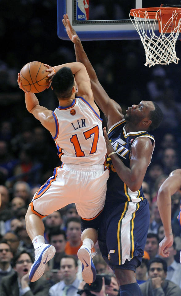 New York Knicks' Jeremy Lin (17) shoots over Utah Jazz's Al Jefferson during the first half of an NBA basketball game Monday, Feb. 6, 2012, in New York. (AP Photo/Kathy Kmonicek)