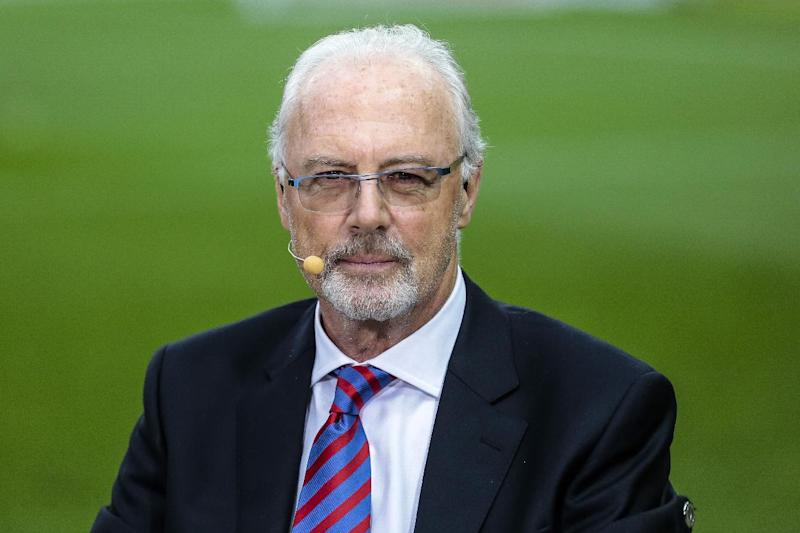 The May 17, 2014 photo shows German soccer legend Franz Beckenbauer attends a television show prior to the German Soccer Cup Final between FC Bayern Munich and Borussia Dortmund at the Olympic Stadium Berlin. Beckenbauer has been banned from football duty for 90 days for snubbing an investigation into Qatar's 2022 World Cup bid. FIFA said Friday, June 13, 2014 the 90-day provisional ban was requested by ethics prosecutor Michael Garcia. Beckenbauer was a voting member of FIFA's executive committee in December 2010 when it chose Qatar, and Russia as 2018 World Cup host