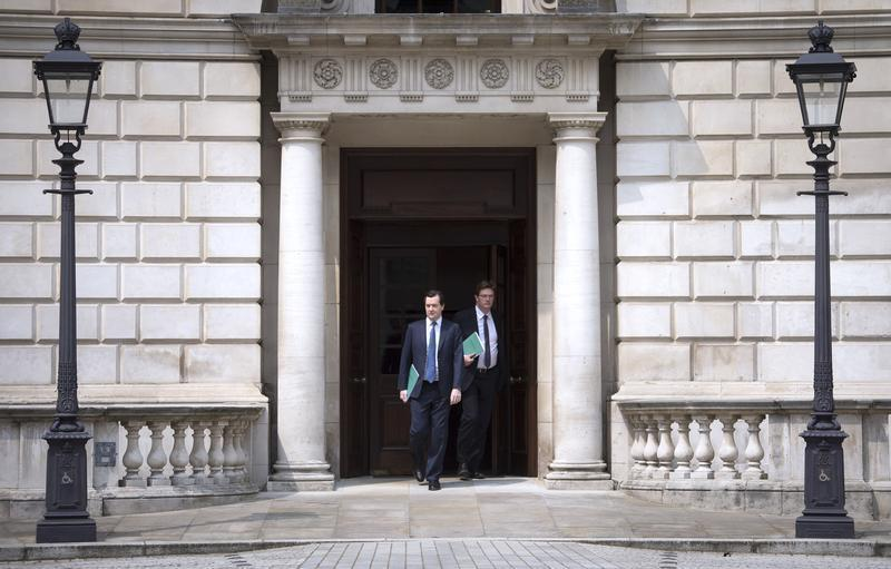 Britain's Chancellor of the Exchequer George Osborne and Chief Secretary to the Treasury Danny Alexander leave the Treasury for the House of Commons in London