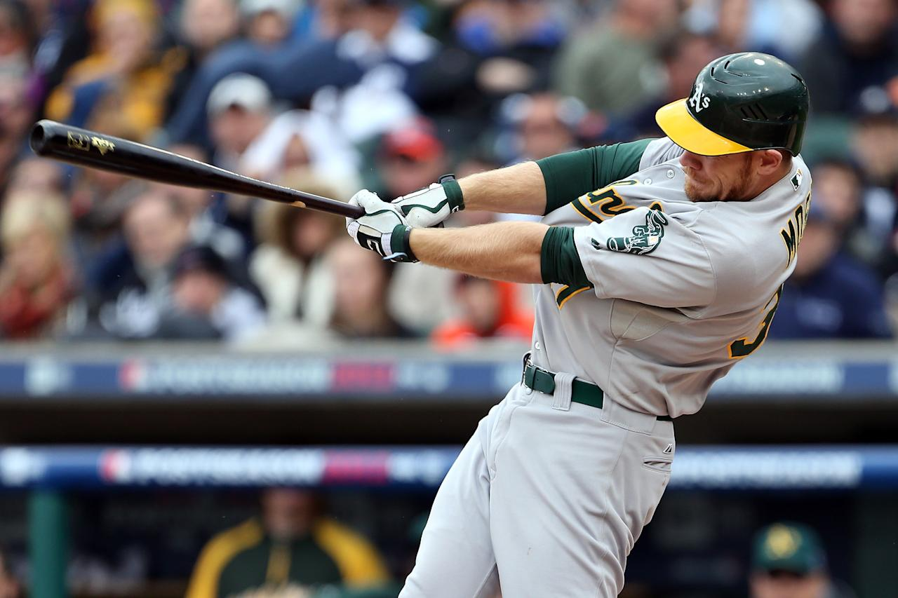 DETROIT, MI - OCTOBER 07:  Brandon Moss #37 of the Oakland Athletics hits a single in the top of the third inning against the Detroit Tigers during Game Two of the American League Division Series at Comerica Park on October 7, 2012 in Detroit, Michigan.  (Photo by Leon Halip/Getty Images)