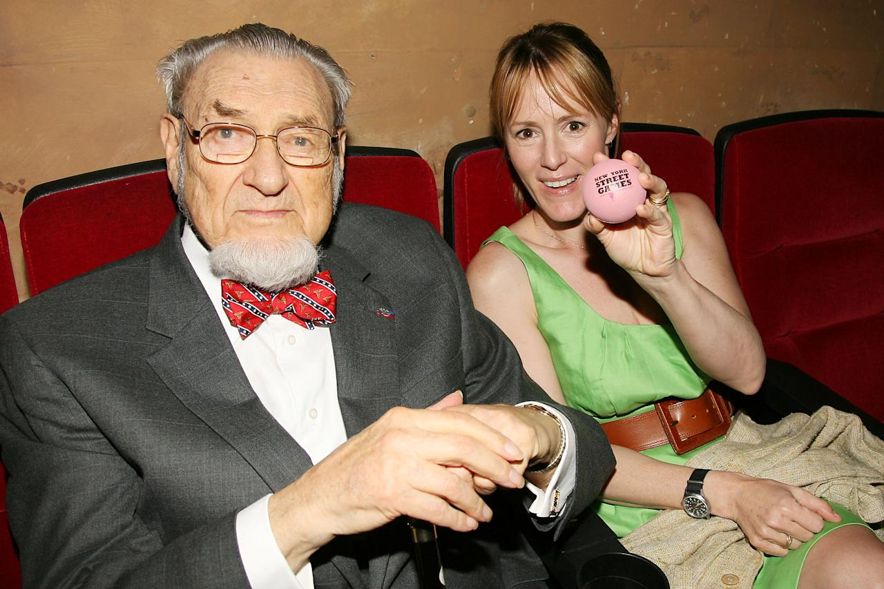 "In this photo released by Starpix, C. Everett Koop, former Surgeon General of the United States joins actress Mary Stuart Masterson at the premiere and DVD release of ""New York Street Games,"" Thursday, May 20, 2010, in New York. The documentary takes a look at games played on the streets of New York as seen through the eyes of prominent New Yorkers. Masterson holds an example of the hollow rubber ball used in the game of ""stickball."" (AP Photo/Starpix, Dave Allocca)"