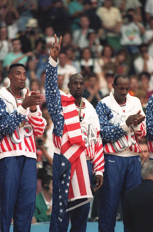 The USA's Scottie Pippen, left, with Michael Jordan, center, and Clyde Drexler, pose with their gold medals after beating Croatia 117-85 in Olympic basketball at Barcelona, Aug. 8, 1992.  (AP Photo/Susan Ragan)