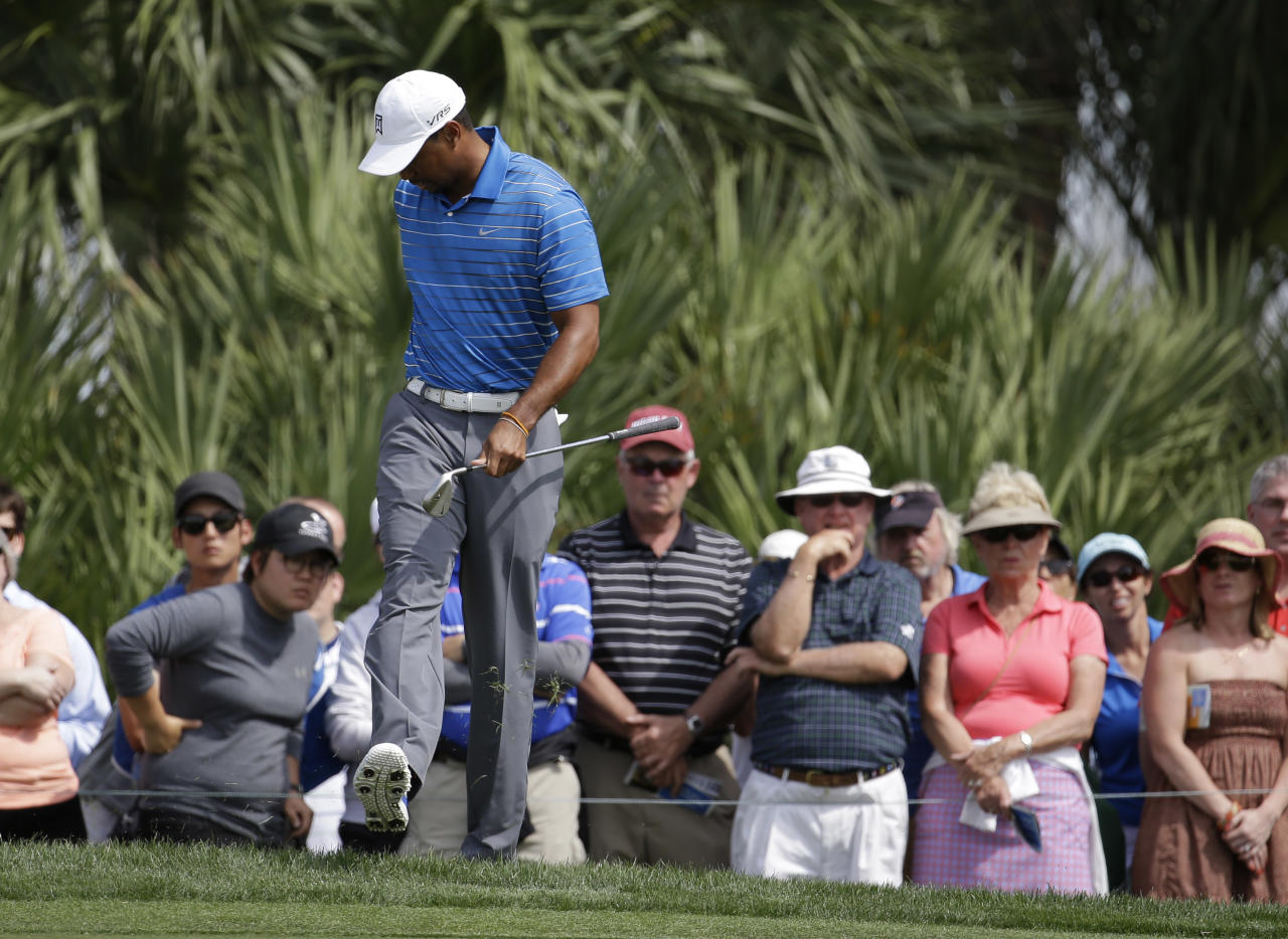 Tiger Woods kicks the ground after over hitting on the eighth green during the first round of the Honda Classic golf tournament, Thursday, Feb. 27, 2014, in Palm Beach Gardens, Fla. (AP Photo/Lynne Sladky)