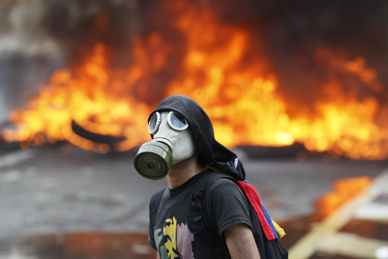 Late-night clashes claim at least 12 in Venezuelan unrest